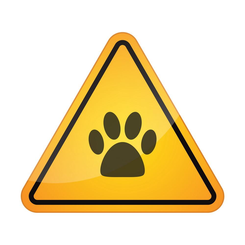 Illustration of a danger signal icon with an animal footprint